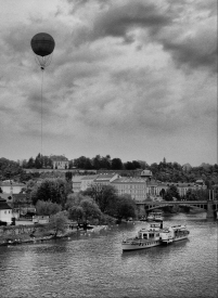 Balloon over river with boat