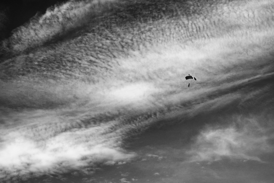 Summer sky with clouds and skydiver